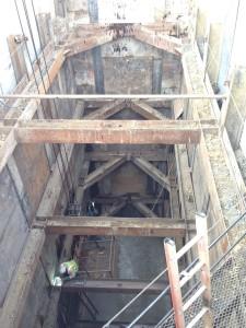worker welding underground metal beam