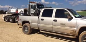 gray pickup truck on dirt road