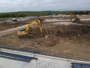 bulldozer digging dirt on construction site
